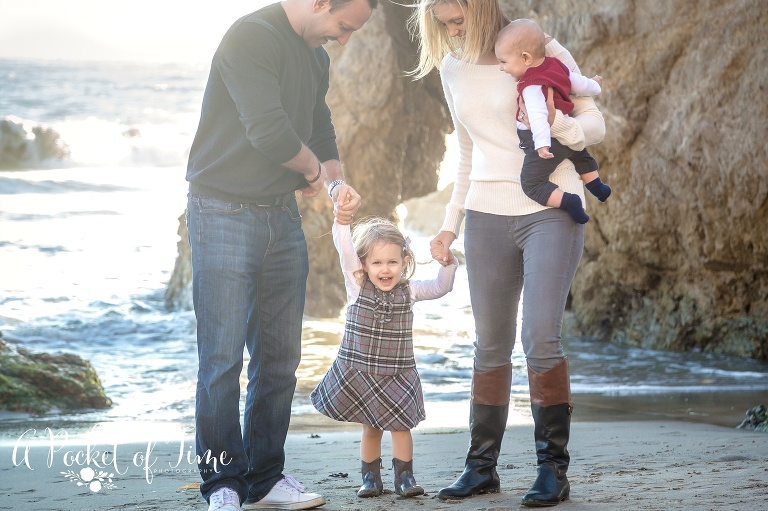 Family photo with a toddler girl and baby boy taken at El Matador beach in Malibu, CA by a pocket of time photography