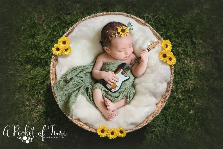 Outdoor newborn photo of a baby girl by Los Angeles newborn photographer A Pocket of Time Photography